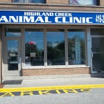 Highland Creek Animal Clinic exterior with blue and white sign